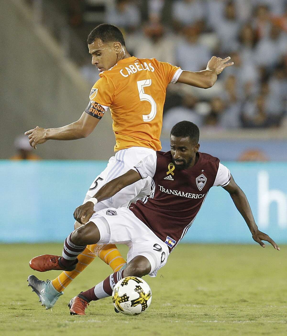 9/9/17: Houston Dynamo midfielder Juan David Cabezas (5) ktrips Colorado Rapids midfielder Mohammed Saeid (90) in the first half in a MLS game at BBVA stadium in Houston, TX