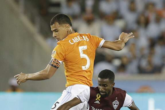 9/9/17: Houston Dynamo midfielder Juan David Cabezas (5) ktrips Colorado Rapids midfielder Mohammed Saeid (90) in the first half in a MLS game at BBVA stadium in Houston, TX