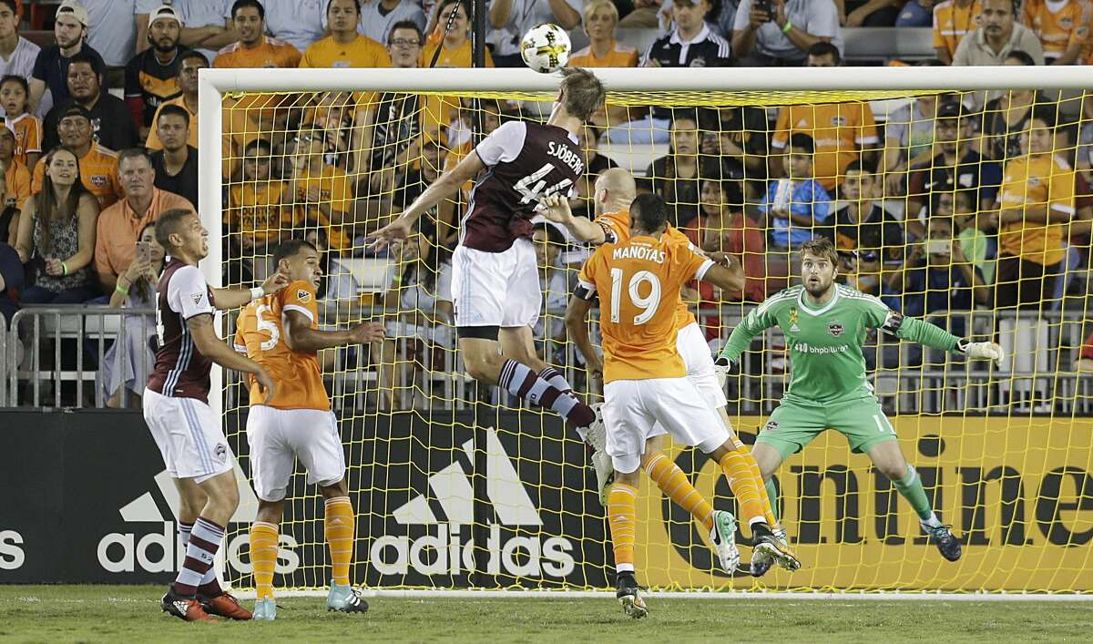 9/9/17: Colorado Rapids defender Axel Sjoberg (44) heads the ball on goal against Houston Dynamo goalkeeper Tyler Deric (1) in the first half in a MLS game at BBVA stadium in Houston, TX