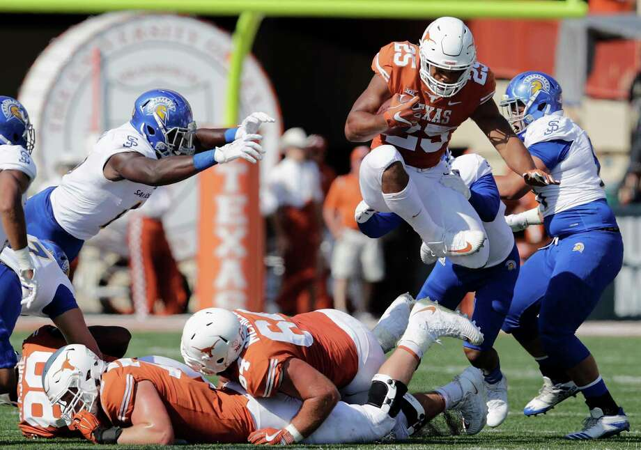 Texas junior running back Chris Warren III, right, now fully healthy, rumbled for 166 rushing yards and two touchdowns in Saturday's win over San Jose State. Photo: Tim Warner, Stringer / 2017 Getty Images