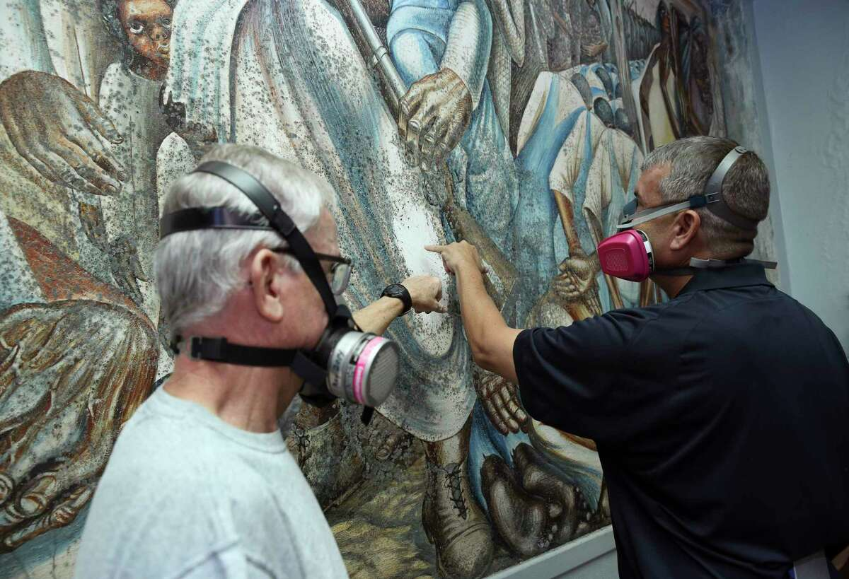 """""""I am happy to say that, from a structural point of view, the mural looks OK,"""" said Elizabeth Mehlin, a Boston painting conservator who came as part of an emergency response team. """"The paint is all right, and it's not flaking, which would have been a much bigger problem."""""""