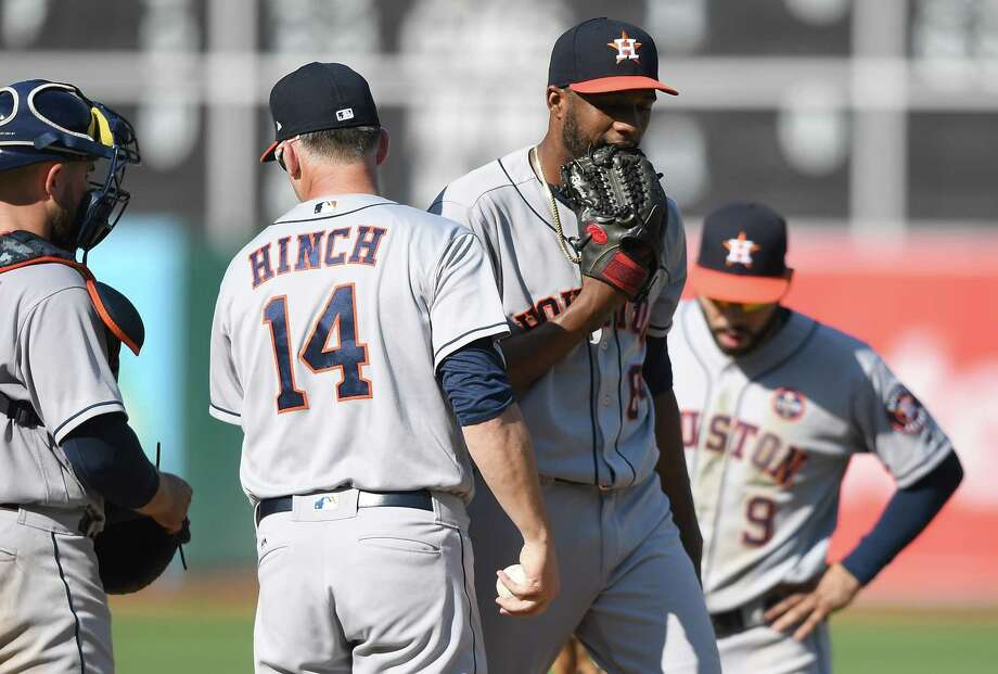 Astros reliever Reymin Guduan, center, could hardly find the strike zone while walking five batters in a row during the eighth inning of Saturday's doubleheader opener, prompting manager A.J. Hinch to remove him. Photo: Thearon W. Henderson, Stringer / 2017 Getty Images
