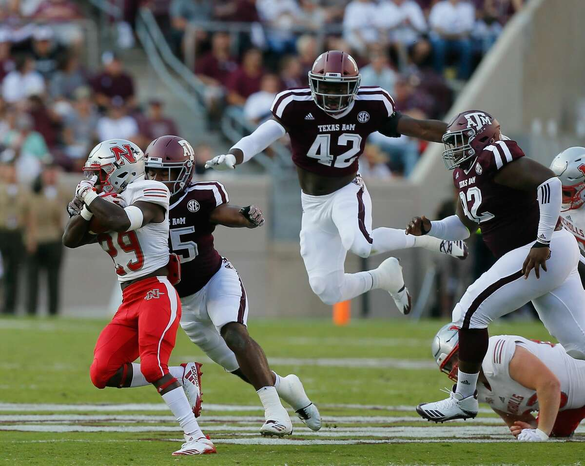COLLEGE STATION, TX - SEPTEMBER 09: Dontrell Taylor #29 of the Nicholls State Colonels is pursued by Tyrel Dodson #25 of the Texas A&M Aggies and Otaro Alaka #42 in the first quarter at Kyle Field on September 9, 2017 in College Station, Texas. (Photo by Bob Levey/Getty Images)