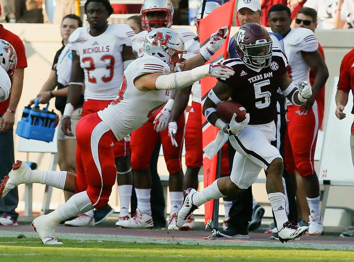 COLLEGE STATION, TX - SEPTEMBER 09: Trayveon Williams #5 of the Texas A&M Aggies is tackled by Evan Veron #48 of the Nicholls State Colonels in the first quarter at Kyle Field on September 9, 2017 in College Station, Texas. (Photo by Bob Levey/Getty Images)