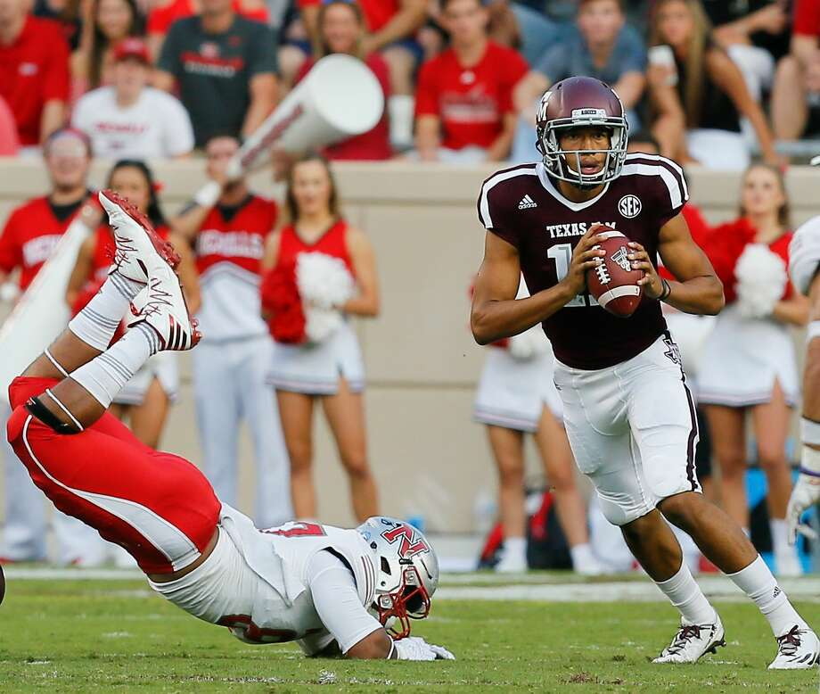 COLLEGE STATION, TX - SEPTEMBER 09:  Kellen Mond #11 of the Texas A&M Aggies scrambles out of the pocket to avoid a tackle by Terrell Encalade #87 of the Nicholls State Colonels in the second quarter at Kyle Field on September 9, 2017 in College Station, Texas.  (Photo by Bob Levey/Getty Images) Photo: Bob Levey/Getty Images