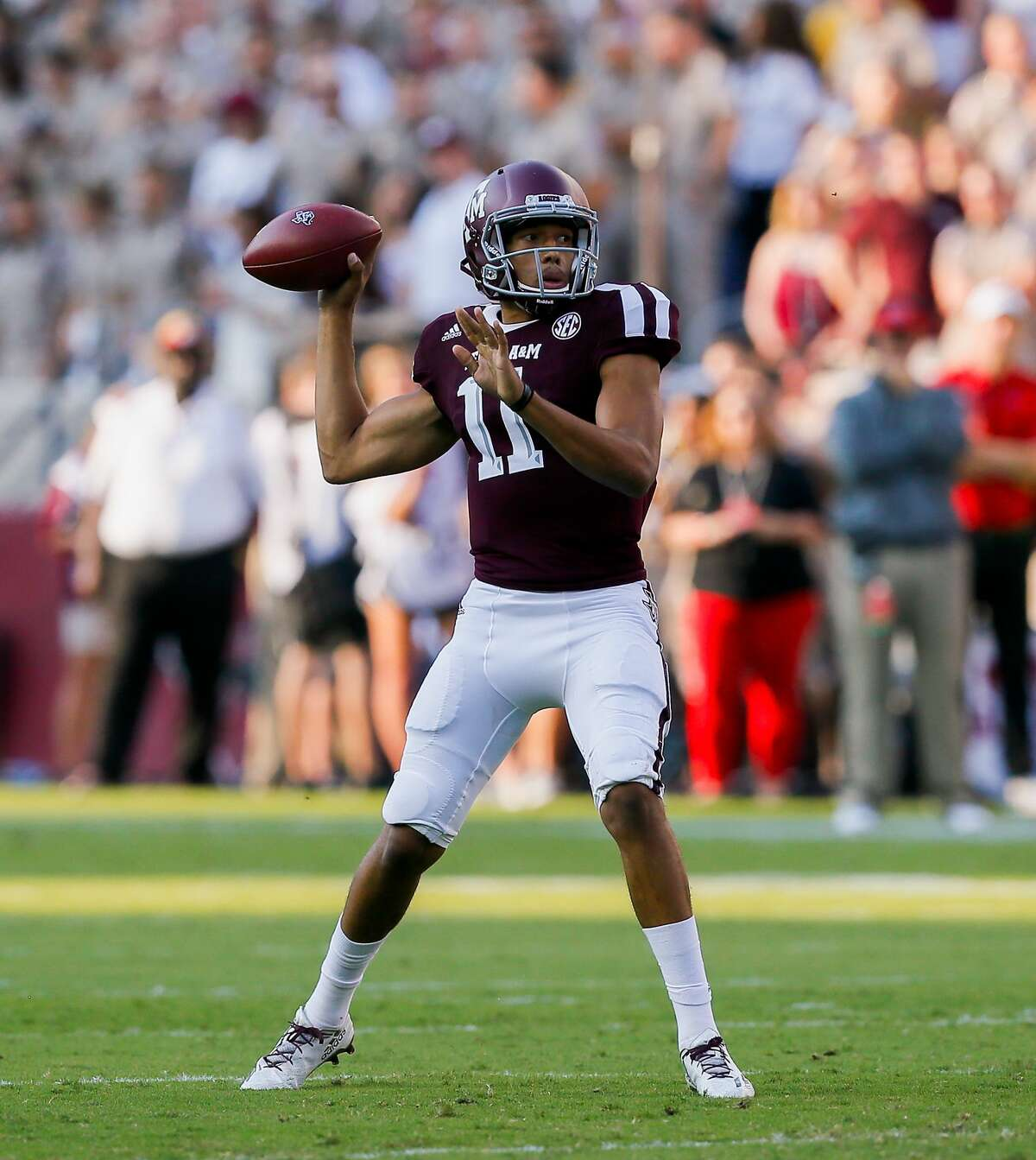 COLLEGE STATION, TX - SEPTEMBER 09: Kellen Mond #11 of the Texas A&M Aggies throws a touchdown pass in the first quarter against the Nicholls State Colonels at Kyle Field on September 9, 2017 in College Station, Texas. (Photo by Bob Levey/Getty Images)