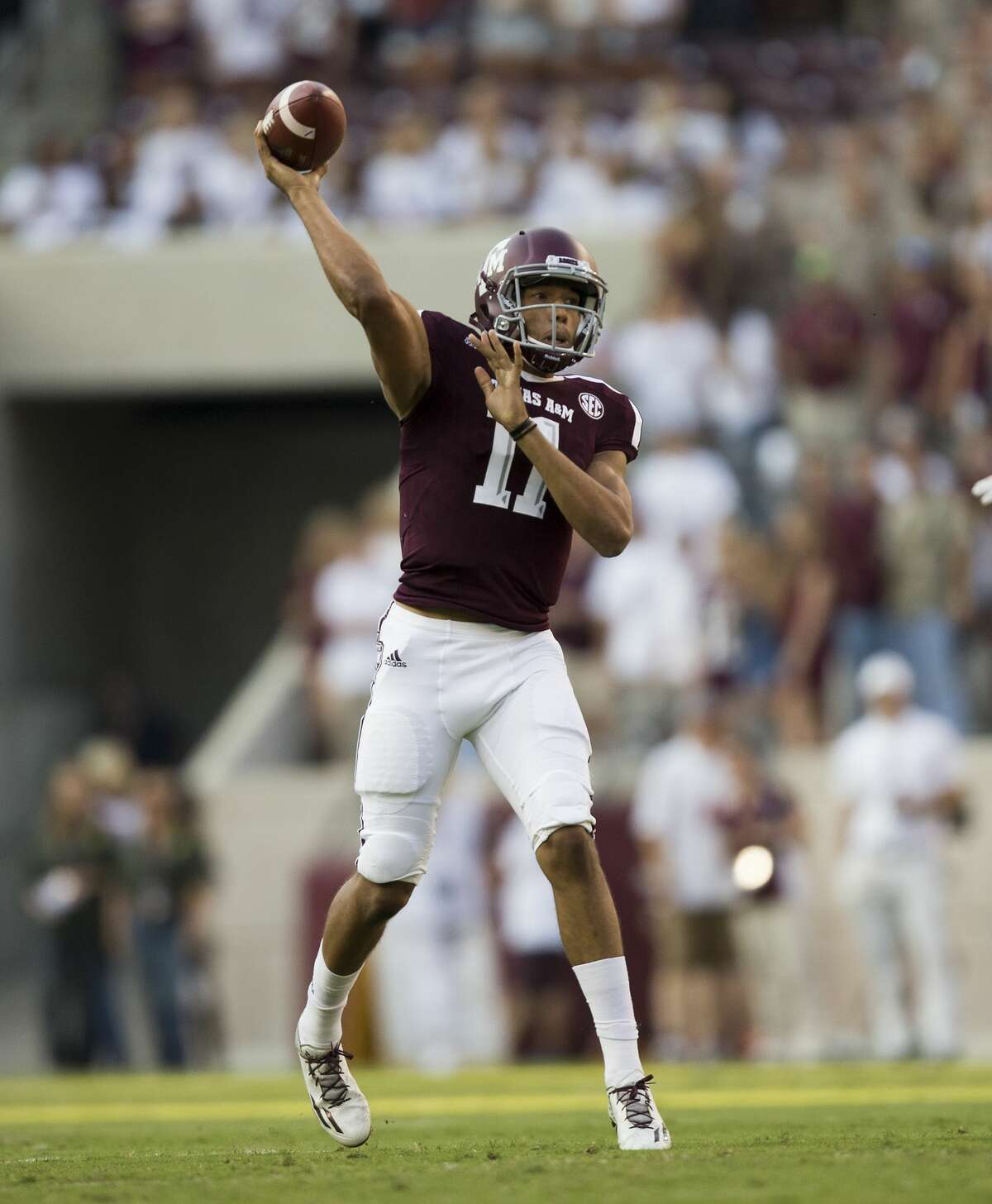 Texas A&M quarterback Kellen Mond (11) passes downfield against Nicholls State during the first quarter of an NCAA college football game Saturday, Sept. 9, 2017, in College Station, Texas. (AP Photo/Sam Craft)