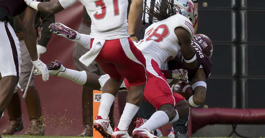 Texas A&M running back Trayveon Williams (5) dives over the goal line for a touchdown against Nicholls State during the first quarter of an NCAA college football game Saturday, Sept. 9, 2017, in College Station, Texas. (AP Photo/Sam Craft) Photo: Sam Craft/Associated Press