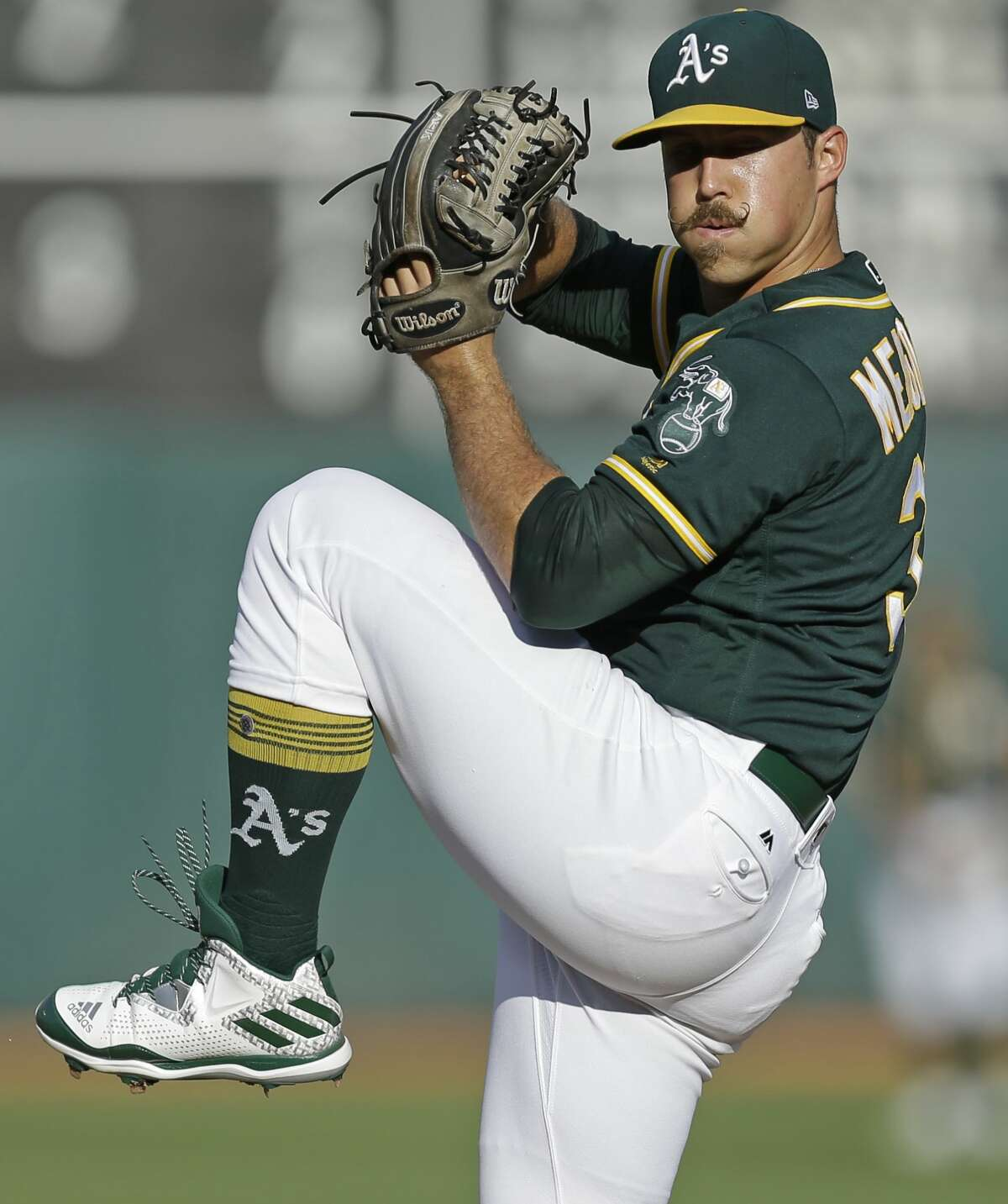 Oakland Athletics pitcher Daniel Mengden works against the Houston Astros in the first inning of the second baseball game of a doubleheader on Saturday, Sept. 9, 2017, in Oakland, Calif. (AP Photo/Ben Margot)