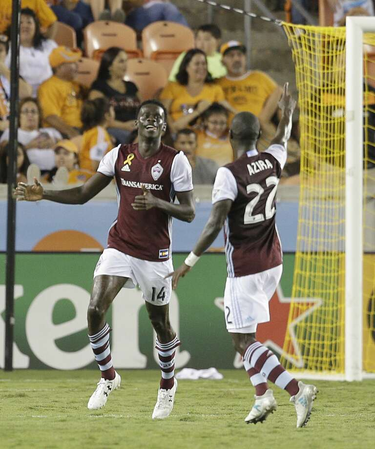 9/9/17: Colorado Rapids midfielder Michael Azira (22) celebrates Colorado Rapids midfielder Dominique Badji (14) goal agains the Houston Dynamo in the second half in a MLS game at BBVA stadium in Houston, TX. Colorado Rapids won 1 to 0. Photo: Thomas B. Shea/For The Chronicle