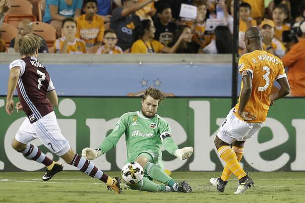 9/9/17:  Houston Dynamo goalkeeper Tyler Deric (1) makes a save on Colorado Rapids forward Stefan Aigner (7) in the second half in a MLS game at BBVA stadium in Houston, TX. Colorado Rapids won 1 to 0.