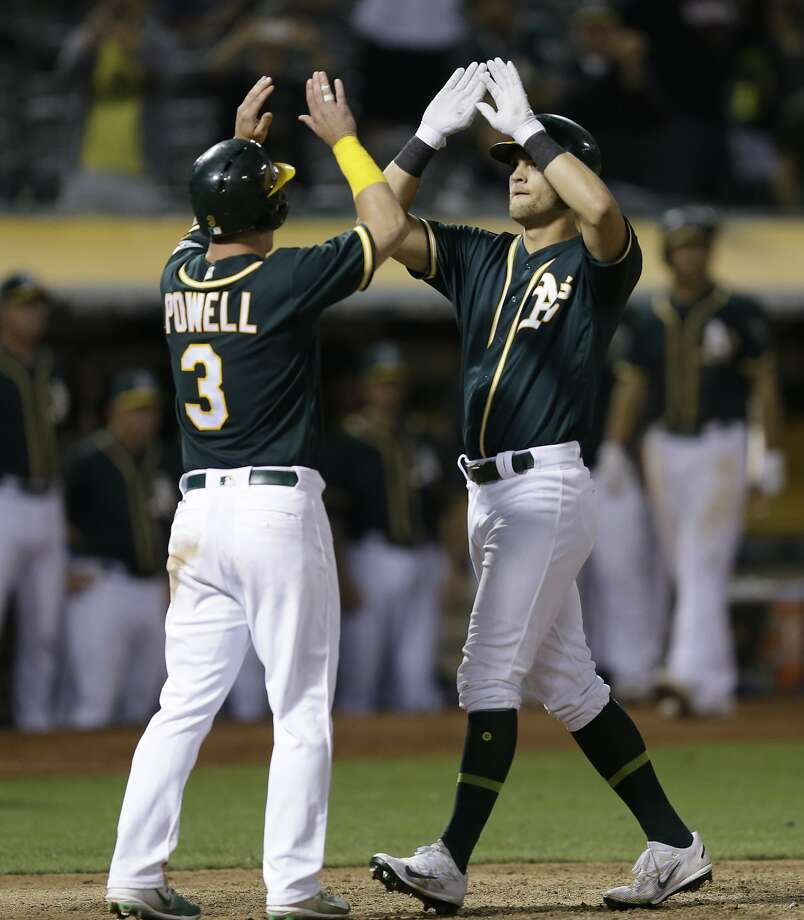 Oakland Athletics' Chad Pinder, right, celebrates with Boog Powell (3) after hitting a three-run home run off Houston Astros' Michael Feliz in the eighth inning of the second baseball game of a doubleheader on Saturday, Sept. 9, 2017, in Oakland, Calif. (AP Photo/Ben Margot) Photo: Ben Margot, Associated Press