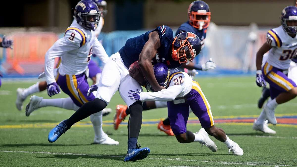 UAlbany cornerback Kareem Browns puts a hard hit on a Morgan State player in their game at Hughes Stadium in Baltimore on Saturday, Sept. 9, 2017. (Mark Coleman / UAlbany Athletics)