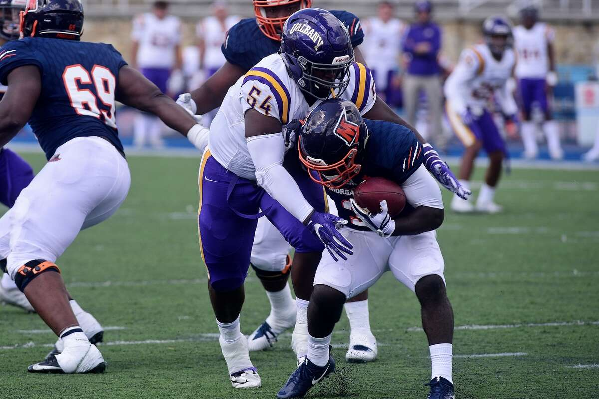 UAlbany defensive lineman Nick Dillon puts a hit on a Morgan State ball carrier in their game at Hughes Stadium in Baltimore on Saturday, Sept. 9, 2017. (Mark Coleman / UAlbany Athletics)