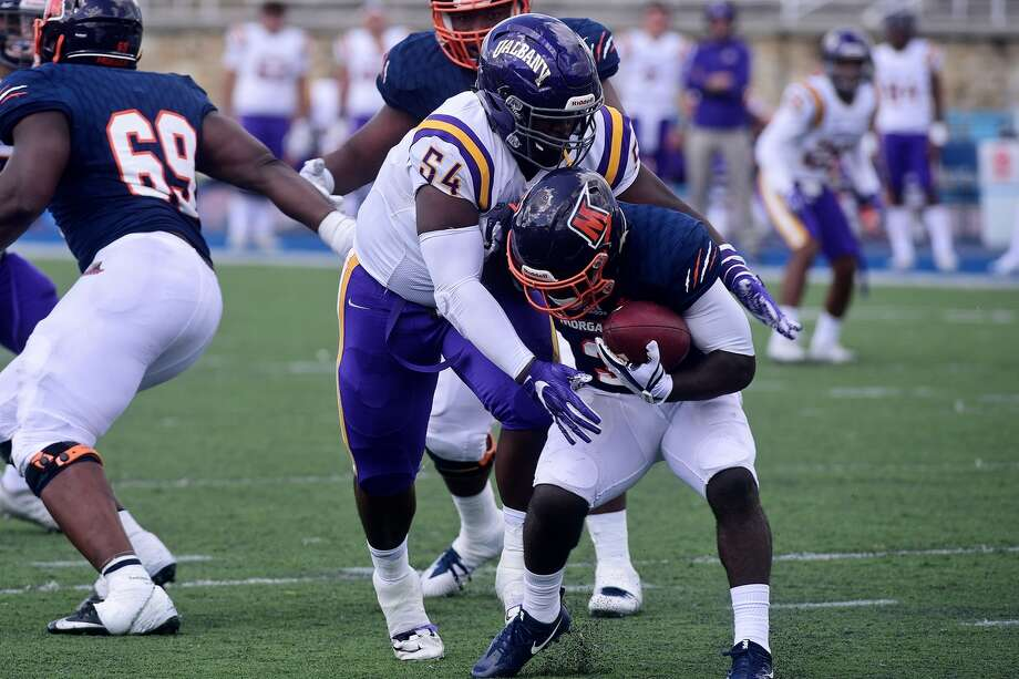 UAlbany defensive lineman Nick Dillon puts a hit on a Morgan State ball carrier in their game at Hughes Stadium in Baltimore on Saturday, Sept. 9, 2017. (Mark Coleman / UAlbany Athletics) Photo: Mjcphoto@hotmail.com