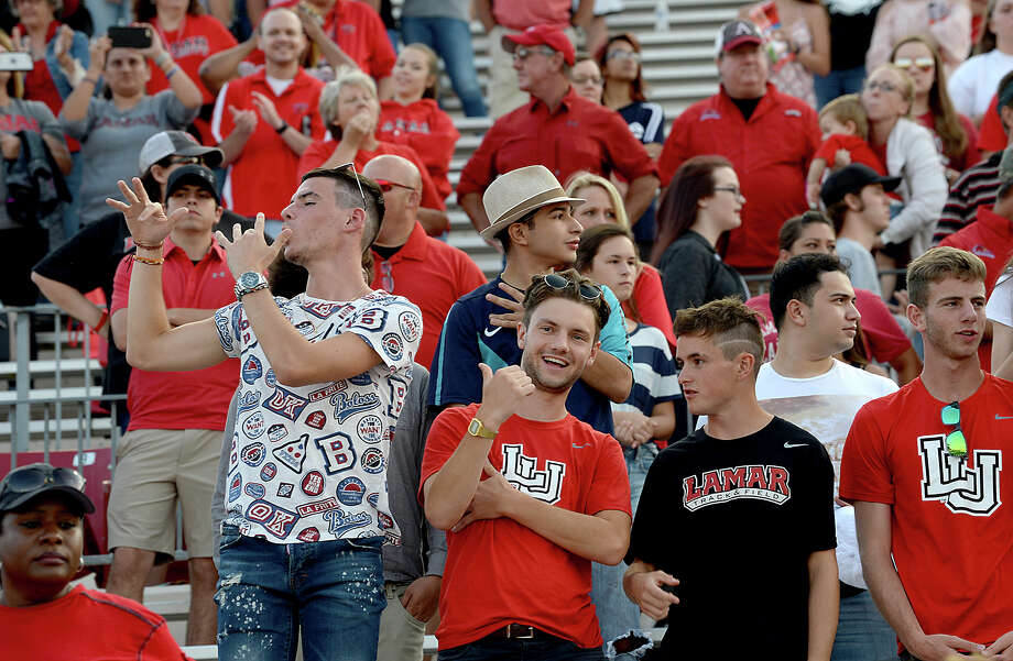 Lamar's fans get into the LU spirit during Saturday's season home opener against UT Permian Basin. The Cardinals game was free entry, with the stands largely full by the end of the first quarter. It was among the ways the university is trying to give back to the community, offering a taste of normal life for citizens and students alike in the wake of Tropical Storm Harvey. Photo taken Saturday, September 9, 2017 Kim Brent/The Enterprise Photo: Kim Brent / BEN