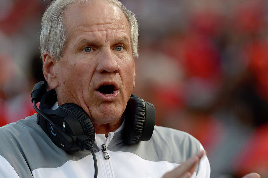 Lamar's head coach Mike Schultz calls out instructions on game play during Saturday's season home opener against UT Permian Basin. The Cardinals game was free entry, with the stands largely full by the end of the first quarter. It was among the ways the university is trying to give back to the community, offering a taste of normal life for citizens and students alike in the wake of Tropical Storm Harvey. Photo taken Saturday, September 9, 2017 Kim Brent/The Enterprise Photo: Kim Brent / BEN