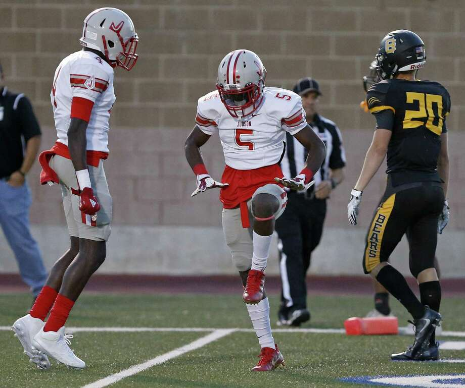 Judson's Kishaun Fisher (center) celebrates with teammate Keith Jefferson after scoring a touchdown on a pass play against Brennan's Kaden Issacks during first half action Saturday Sept. 9, 2017 at Farris Stadium. Photo: Edward A. Ornelas, Staff / San Antonio Express-News / © 2017 San Antonio Express-News