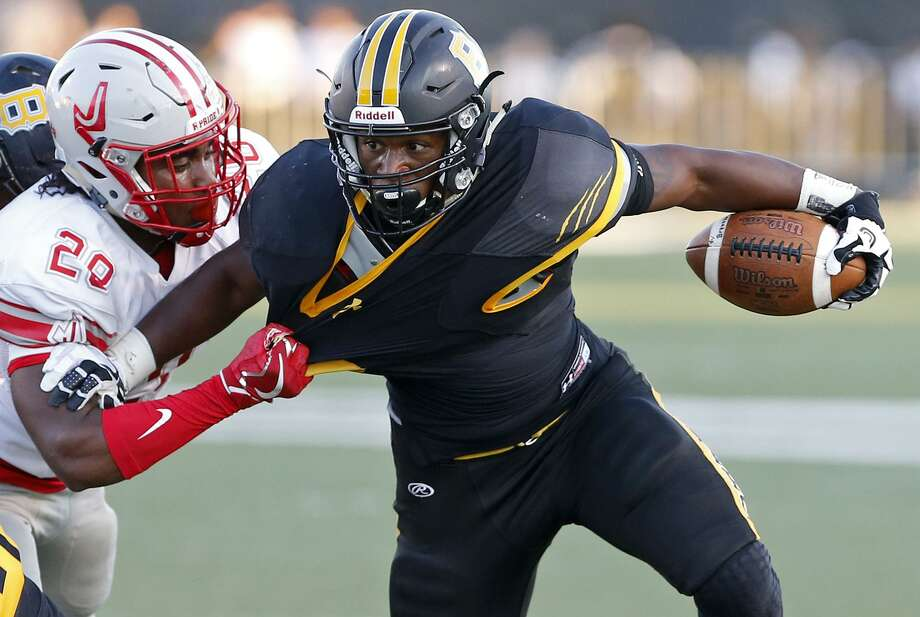Brennan's Jahmyl Jeter (right) tries to shake the tackle of Judson's Kevin Wood during first half action on Sept. 9, 2017 at Farris Stadium. Photo: Edward A. Ornelas /San Antonio Express-News / © 2017 San Antonio Express-News