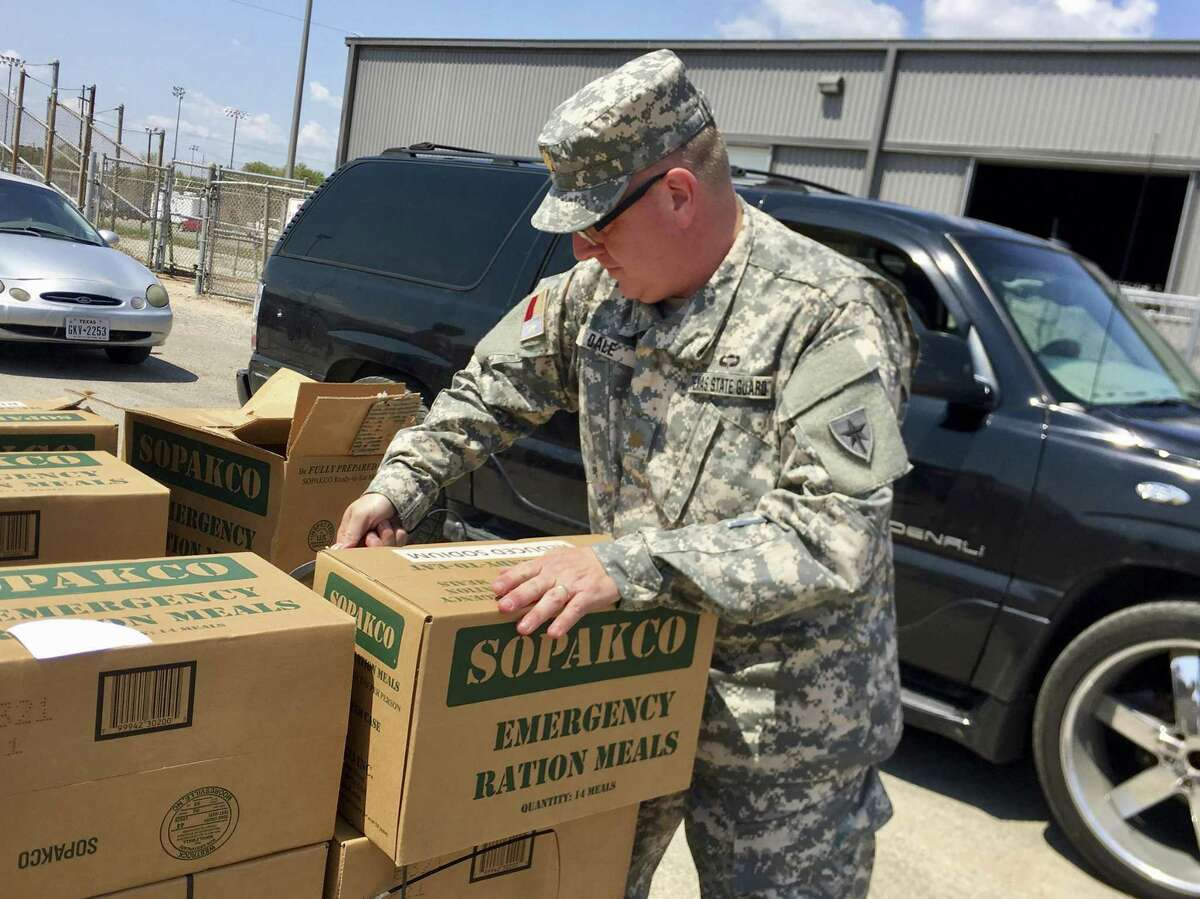 Maj. Tony Dale, a Republican state representative from Cedar Park, helps stack boxes at a food and water distribution center in Victoria last week. As an officer in the Texas State Guard, he and three other state lawmakers were activated in response to Harvey.