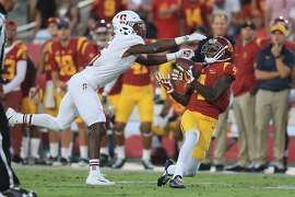 LOS ANGELES, CA - SEPTEMBER 09:  Steven Mitchell Jr. #4 of the USC Trojans attempts to make a reception against Frank Buncom #5 of the Stanford Cardinal during the second quarter at Los Angeles Memorial Coliseum on September 9, 2017 in Los Angeles, California.  (Photo by Sean M. Haffey/Getty Images)