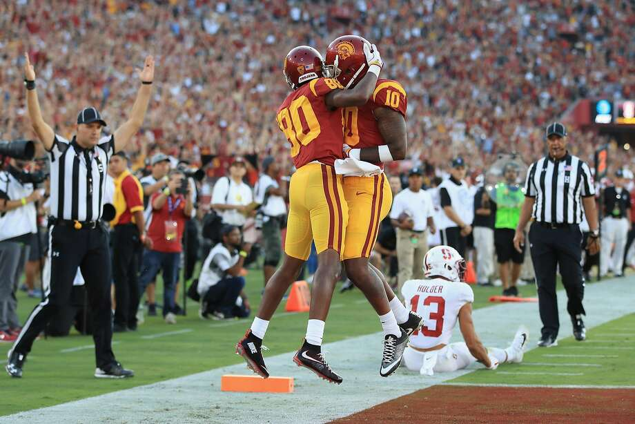 Deontay Burnett #80 of the USC Trojans celebrates with Jalen Greene #10 after scoring a second quarter touchdown against the Stanford Cardinal at Los Angeles Memorial Coliseum on September 9, 2017 in Los Angeles, California. Photo: Sean M. Haffey, Getty Images