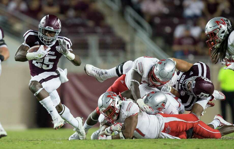 Texas A&M running back Kendall Bussey's fourth-quarter touchdown run put the Aggies ahead for good in Saturday's win over Nicholls State, rebounding from last week's embarrassing loss to UCLA. Photo: Sam Craft, FRE / AP