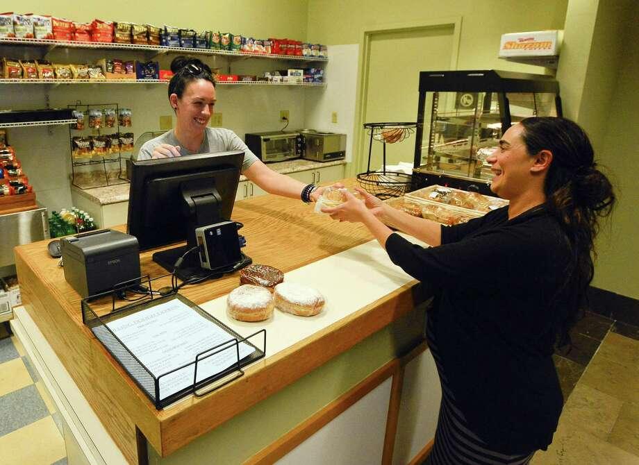 Kaitlyn Jones, an employee of Rolling Dough Express Cafe at the Stamford courthouse helps Amy Brassard, who works in the courthouse with her food purchases on Friday, Sept. 8, 2017 in Stamford, Connecticut. The cafe, which had been closed for over a year, recently reopened to the delight of Jurors and employees. Photo: Matthew Brown / Hearst Connecticut Media / Stamford Advocate