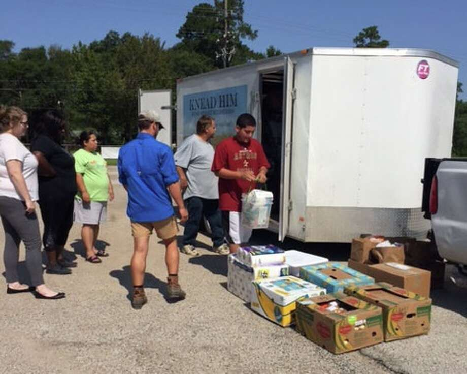 """Mark Rust of Rust Street Ministries from San Angelo, Texas, arrived in Shepherd, Texas, early Saturday morning, Sept. 9. The ministry delivered supplies to six Shepherd ISD staff members and student families. Several of Shepherd ISD families have suffered loss during HurricaneHarvey. Each of the families receivedfurniture, clothing, food, household items and cash gift cards. """"With heartfelt gratitude, we thank our neighborsfrom across the state,"""" a statement from the district reads. Photo: Submitted"""