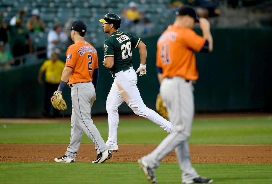 OAKLAND, CA - SEPTEMBER 09:  Matt Olson #28 of the Oakland Athletics trots around the bases after hitting a two-run homer off of Brad Peacock #41 of the Houston Astros in the bottom of the six inning of the second game in a double header at Oakland Alameda Coliseum on September 9, 2017 in Oakland, California.  (Photo by Thearon W. Henderson/Getty Images) Photo: Thearon W. Henderson, Getty Images