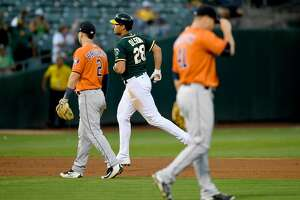 OAKLAND, CA - SEPTEMBER 09:  Matt Olson #28 of the Oakland Athletics trots around the bases after hitting a two-run homer off of Brad Peacock #41 of the Houston Astros in the bottom of the six inning of the second game in a double header at Oakland Alameda Coliseum on September 9, 2017 in Oakland, California.  (Photo by Thearon W. Henderson/Getty Images)