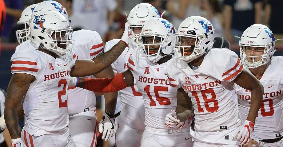 TUCSON, AZ - SEPTEMBER 09:  Wide receiver Linell Bonner #15 of the Houston Cougars celebrates with Duke Catalon #2 and Keith Corbin #18 after scoring a five yard touchdown against the Arizona Wildcats in the first half at Arizona Stadium on September 9, 2017 in Tucson, Arizona.  (Photo by Jennifer Stewart/Getty Images) Photo: Jennifer Stewart/Getty Images