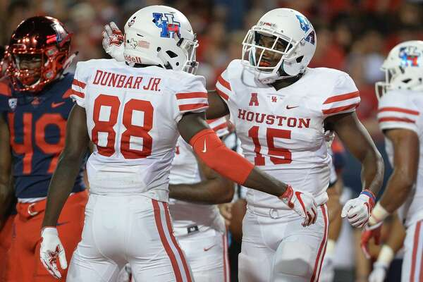 TUCSON, AZ - SEPTEMBER 09:  Wide receiver Linell Bonner #15 of the Houston Cougars celebrates with wide receiver Steven Dunbar #88 after scoring a five yard touchdown against the Arizona Wildcats in the first half at Arizona Stadium on September 9, 2017 in Tucson, Arizona.  (Photo by Jennifer Stewart/Getty Images)