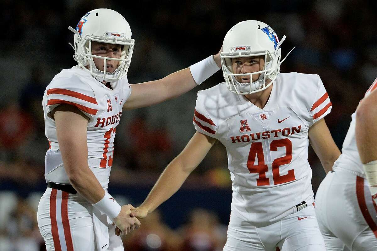 TUCSON, AZ - SEPTEMBER 09: Mason McClendon #13 and place kicker Caden Novikoff #42 of the Houston Cougars celebrate after scoring a field goal in the first half against the Arizona Wildcats at Arizona Stadium on September 9, 2017 in Tucson, Arizona. (Photo by Jennifer Stewart/Getty Images)