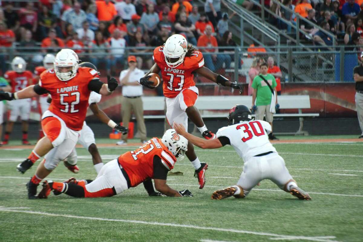 La Porte's Brandon Collins (33) leaps over teammate Glen Anderson (22) as he runs for yardage against Clear Brook Saturday, Sep. 9 at La Porte High School.