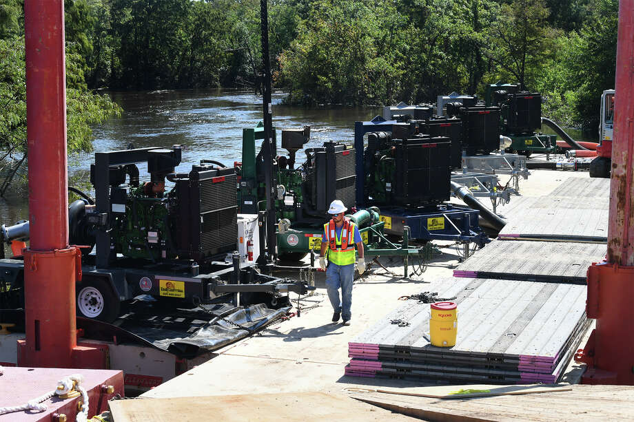 Six large pumps draw water from a bend in the Neches River in Beaumont Friday. Housed on a floating barge, the pump are part of a collective effort between the city and Tiger Industrial Rentals to restore water to residents. Photo taken Friday, September 08, 2017 Guiseppe Barranco/The Enterprise Photo: Guiseppe Barranco, Photo Editor / Guiseppe Barranco ©