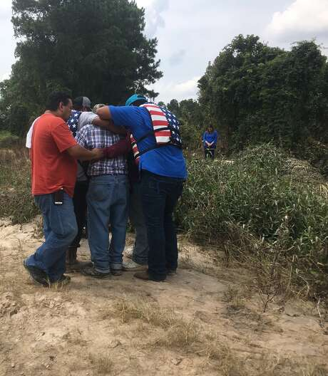 Alonso Guillen's family embraced after seeing his body floating inCypressCreek on Sunday afternoon. Guillen, 31, was one of three volunteer rescuers who drove from Lufkin down to Houston to help people stranded by Tropical Storm Harvey. Their boat hit the Interstate 45 frontage road bridge overCypressCreek and capsized, sending them all into the rushing water.