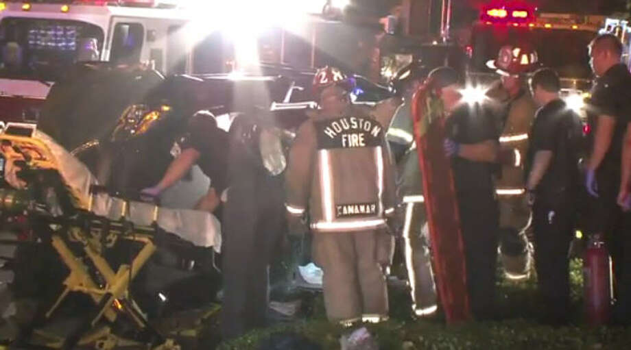 A woman was extricated from an overturned SUV following a dramatic wreck. Photo: Metro Video
