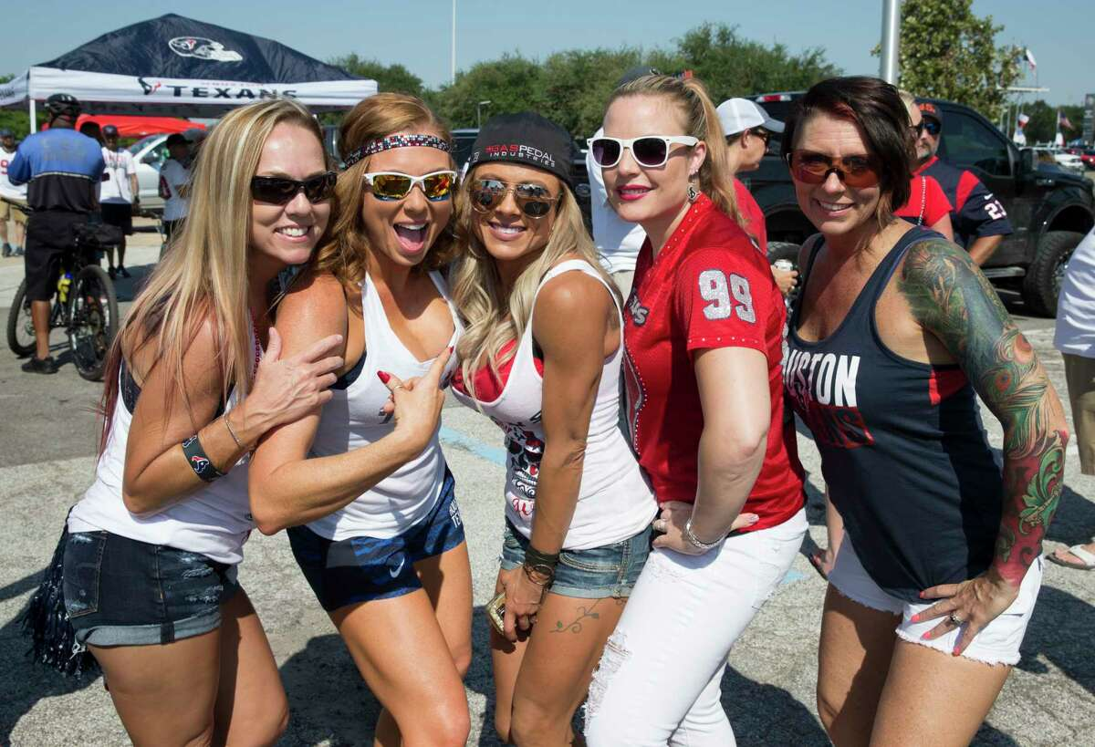 Houston Texans fans pose for a photograph before the team takes on Jacksonville Jaguars Sunday, Sept. 10, 2017, in Houston.