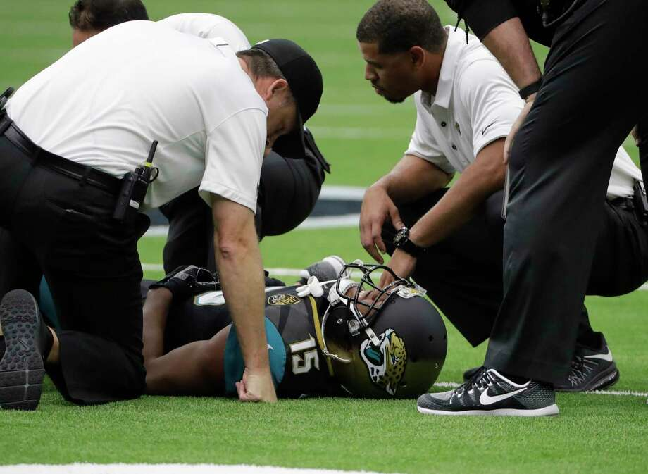 Jacksonville Jaguars wide receiver Allen Robinson (15) is tended to by medical staff after an injury while facing the Houston Texans in the first half of an NFL football game Sunday, Sept. 10, 2017, in Houston. (AP Photo/David J. Phillip) Photo: David J. Phillip, Associated Press / Copyright 2017 The Associated Press. All rights reserved.