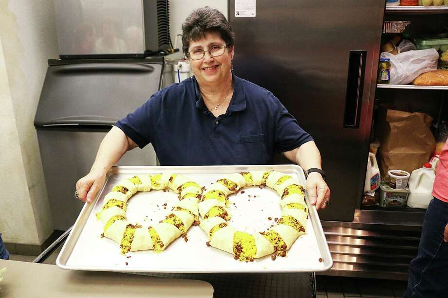 Jo George prepares to slide a pan of her famous taco rings into the oven. George was among the many volunteers who helped in the kitchen at First Baptist Church during the storm. Photo: David Taylor