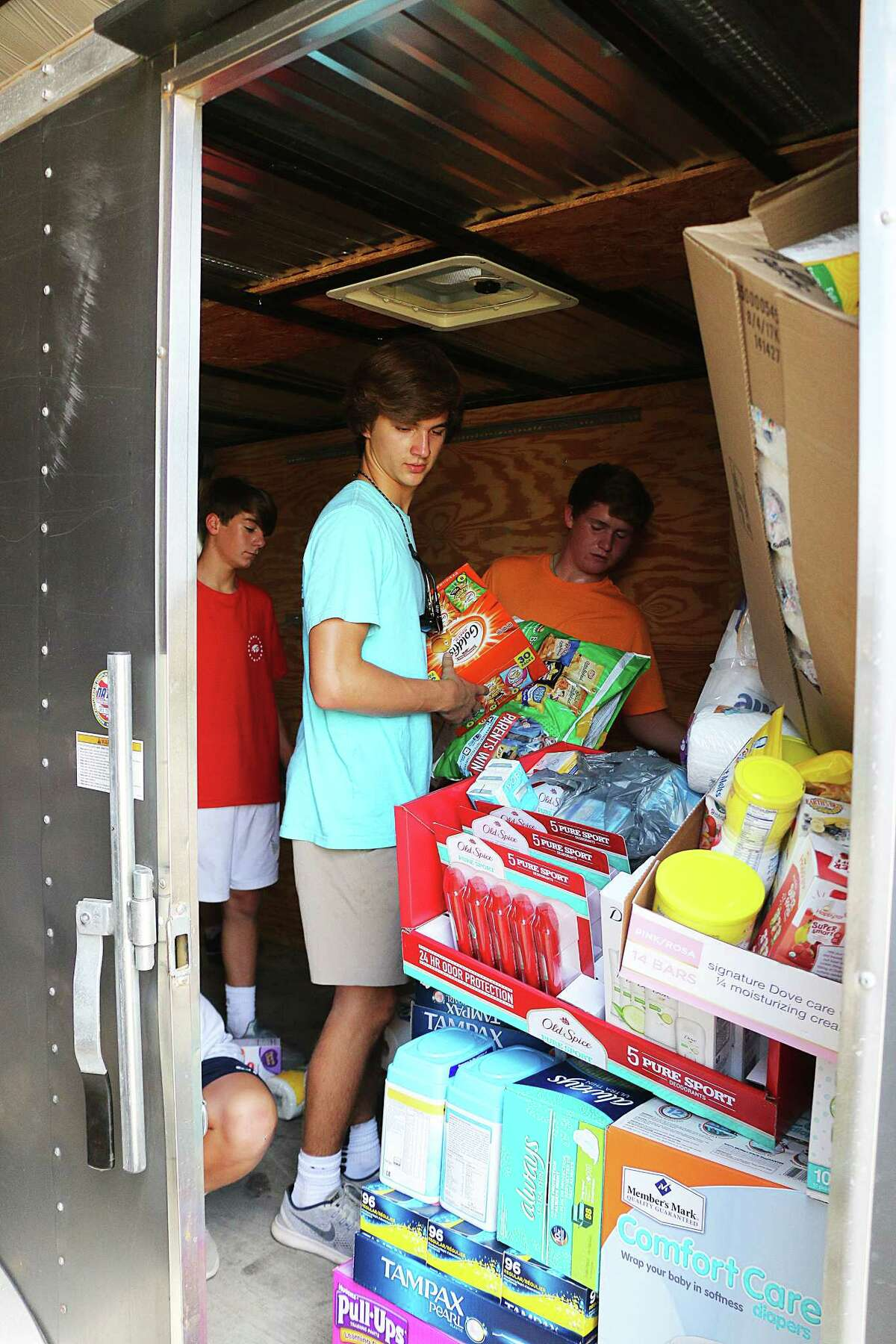 Students from two Fort Worth schools travel to Dayton to deliver supplies for victims of the worst flooding in the history of the county. While most of the water had subsided by the time they had arrived, their donations were delivered to needy residents by Commissioner Leon Wilson.