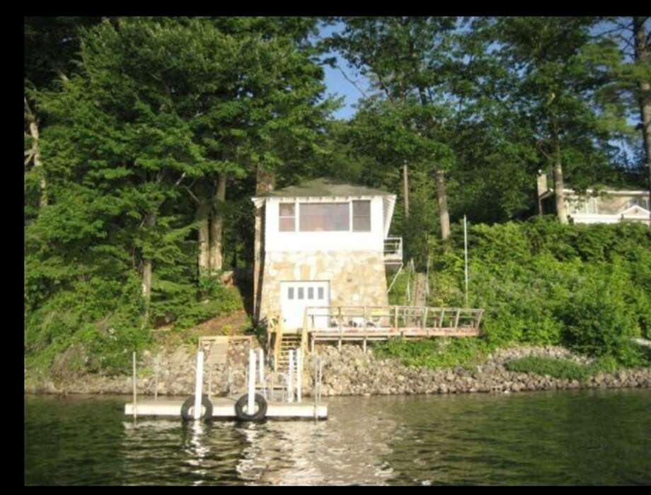 """Adirondacks:Schroon Lake, NY. Adirondack Lake Front Guest Cottage . Price: $200.""""Quiet and quaint. This classic Adirondack guest cottage is the perfect getaway. Originally built in 1945 as a boat house. Updated with a kitchen and new bathroom, it is charming and serene. A true """"On Golden Pond"""" experience. The moment you enter, you will be struck by the captivating view of Schroon lake surrounded by Pines, Cedar, Maple and Oak trees. A bird lovers sanctuary."""" View full listing on Airbnb. Photo: Courtesy Of Airbnb"""