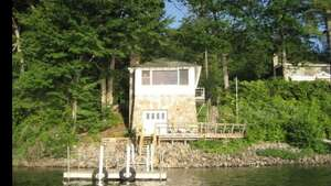 """Schroon Lake, NY . Adirondack Lake Front Guest Cottage . Price: $200. """"Quiet and quaint. This classic Adirondack guest cottage is the perfect getaway. Originally built in 1945 as a boat house. Updated with a kitchen and new bathroom, it is charming and serene. A true """"On Golden Pond"""" experience. The moment you enter, you will be struck by the captivating view of Schroon lake surrounded by Pines, Cedar, Maple and Oak trees. A bird lovers sanctuary.""""    View full listing on Airbnb  ."""