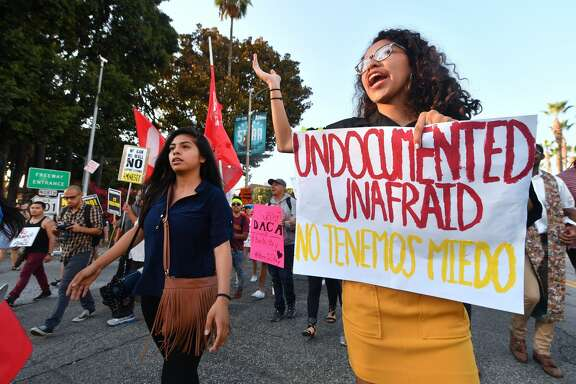 """Young immigrants, activists and supporters of the DACA program march through downtown Los Angeles, California on September 5, 2017 after the Trump administration formally announced it will end the DACA (Deferred Action for Childhood Arrivals) program, giving Congress six months to act. US President Donald Trump ended an amnesty protecting 800,000 people brought to the US illegally as minors from deportation. """"I am here today to announce that the program known as DACA that was effectuated under the Obama Administration is being rescinded,"""" US Attorney General Jeff Sessions announced. / AFP PHOTO / FREDERIC J. BROWN        (Photo credit should read FREDERIC J. BROWN/AFP/Getty Images)"""
