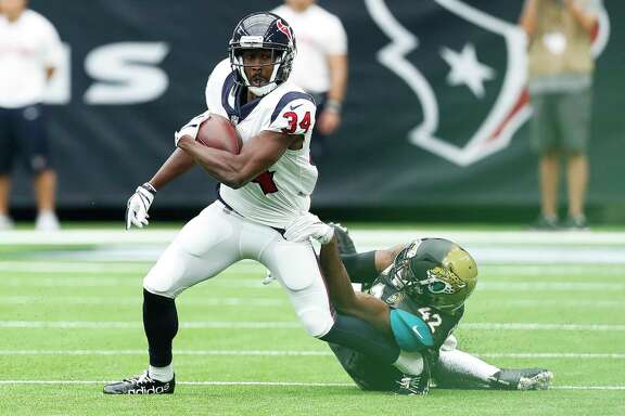 Houston Texans running back Tyler Ervin (34) runs with the ball past Jacksonville Jaguars strong safety Barry Church (42) during the first quarter of an NFL football game at NRG Stadium on Sunday, Sept. 10, 2017, in Houston.