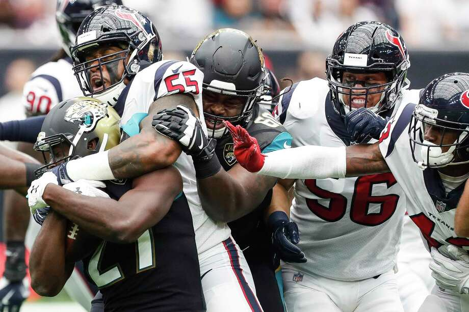 Houston Texans inside linebacker Benardrick McKinney (55) wraps up Jacksonville Jaguars running back Leonard Fournette (27) during the first quarter of an NFL football game at NRG Stadium on Sunday, Sept. 10, 2017, in Houston. Photo: Brett Coomer, Houston Chronicle / © 2017 Houston Chronicle