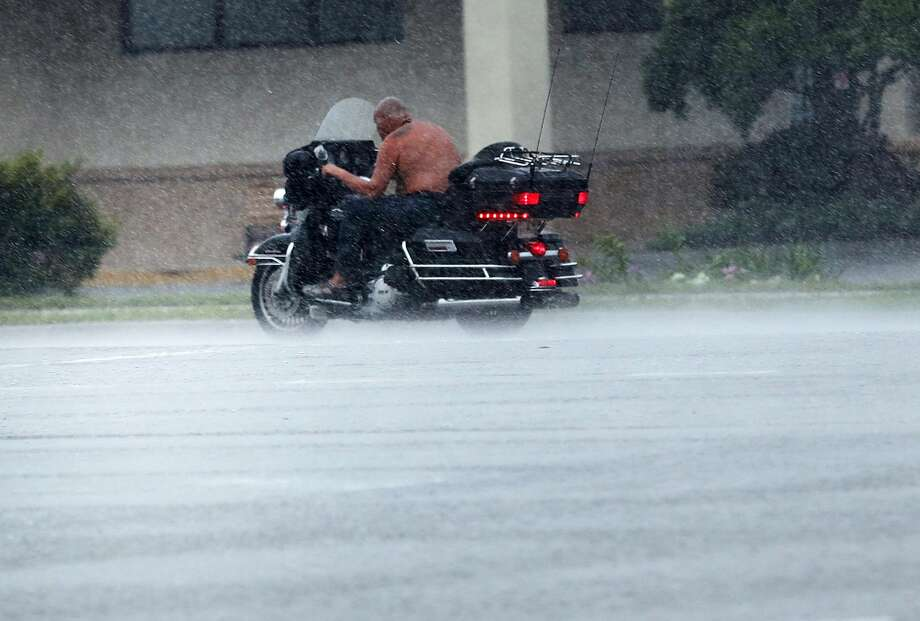 A man rides a motorcycle through the wind and rain as Hurricane Irma arrives into southwest Florida on September 10, 2017 in Bonita Springs, Florida. With businesses closed, thousands in shelters and a mandatory evacuation in coastal communities, the Fort Myers area is preparing for a possibly catastrophic storm.  Photo: Spencer Platt/Getty Images