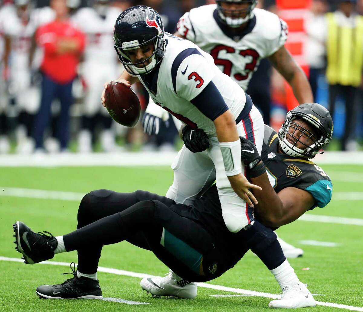 Houston Texans quarterback Tom Savage (3) is sacked by Jacksonville Jaguars defensive tackle Calais Campbell (93) during the second quarter of an NFL football game at NRG Stadium on Sunday, Sept. 10, 2017, in Houston.
