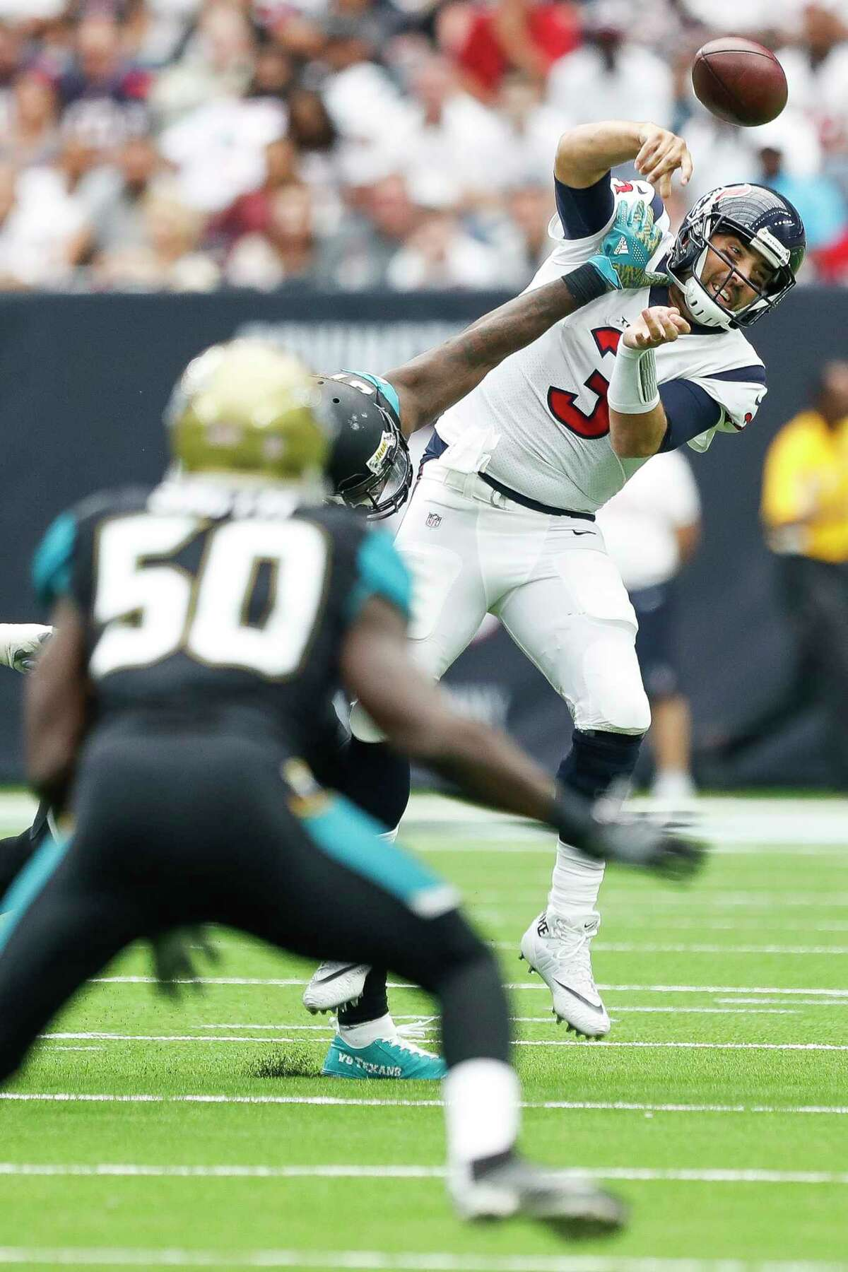 Houston Texans quarterback Tom Savage (3) is hit while making a pass in the second quarter of an NFL football game at NRG Stadium, Sunday, Sept. 10, 2017, in Houston.